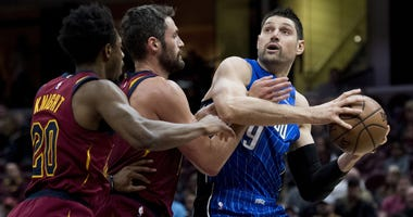 Mar 3, 2019; Cleveland, OH, USA; Orlando Magic center Nikola Vucevic (9) drives to the basket against Cleveland Cavaliers forward Kevin Love (0) and guard Brandon Knight (20) during the first half at Quicken Loans Arena. Mandatory Credit: Ken Blaze-USA TO