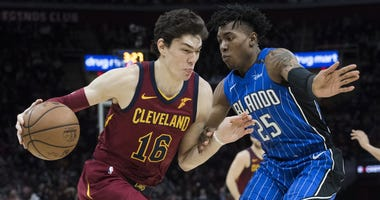 Mar 3, 2019; Cleveland, OH, USA; Cleveland Cavaliers forward Cedi Osman (16) drives to the basket against Orlando Magic forward Wesley Iwundu (25) during the second half at Quicken Loans Arena. Mandatory Credit: Ken Blaze-USA TODAY Sports