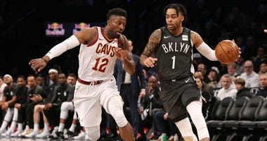 Mar 6, 2019; Brooklyn, NY, USA; Brooklyn Nets point guard D'Angelo Russell (1) controls the ball as Cleveland Cavaliers shooting guard David Nwaba (12) defends during the second quarter at Barclays Center. Mandatory Credit: Brad Penner-USA TODAY Sports