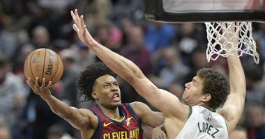 Mar 20, 2019; Cleveland, OH, USA; Cleveland Cavaliers guard Collin Sexton (2) shoots the ball around Milwaukee Bucks center Brook Lopez (11) in the first quarter at Quicken Loans Arena. Mandatory Credit: David Richard-USA TODAY Sports