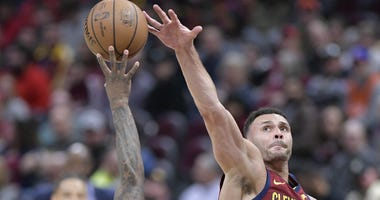 Cleveland Cavaliers forward Larry Nance Jr. (22) blocks a shot by Milwaukee Bucks guard Eric Bledsoe (6) in the third quarter at Quicken Loans Arena.