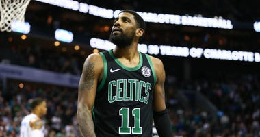 Mar 23, 2019; Charlotte, NC, USA; Boston Celtics guard Kyrie Irving (11) watches a replay after a foul in the second half against the Charlotte Hornets at Spectrum Center. Mandatory Credit: Jeremy Brevard-USA TODAY Sports