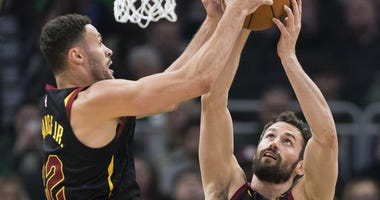 Cleveland Cavaliers forward Larry Nance Jr. (22) and forward Kevin Love (0) reach for a rebound during the first quarter against the Milwaukee Bucks at Fiserv Forum.