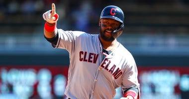 Mar 30, 2019; Minneapolis, MN, USA; Cleveland Indians designated hitter Hanley Ramirez (13) reacts after hitting a solo home run in the top of the fourth inning against the Minnesota Twins at Target Field. Mandatory Credit: David Berding-USA TODAY Sports