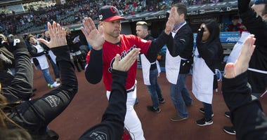 Cleveland Indians starting pitcher Corey Kluber (28) is introduced before the home opening game between the Cleveland Indians and the Chicago White Sox at Progressive Field.