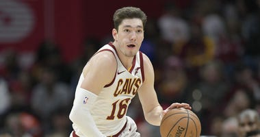 Apr 7, 2019; Cleveland, OH, USA; Cleveland Cavaliers forward Cedi Osman (16) brings the ball up court in the third quarter against the San Antonio Spurs at Quicken Loans Arena. Mandatory Credit: David Richard-USA TODAY Sports