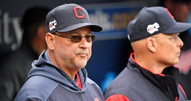 Cleveland Indians manager Terry Francona (left) looks on from the dugout before the start of the game against the Kansas City Royals at Kauffman Stadium.