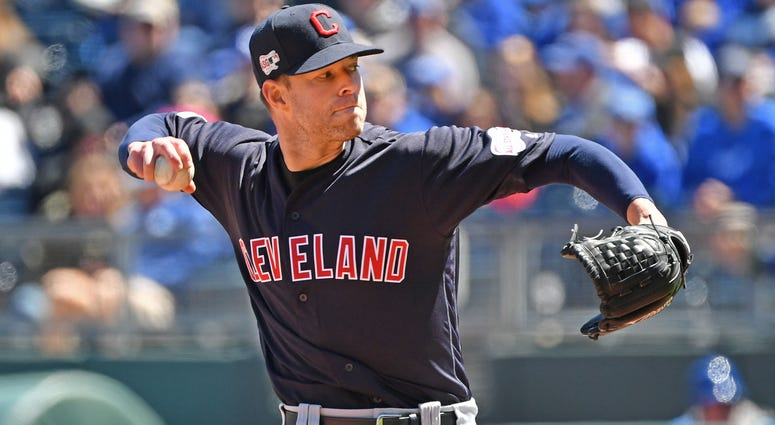 Apr 14, 2019; Kansas City, MO, USA; Cleveland Indians starting pitcher Corey Kluber (28) delivers a pitch during the first inning against the Kansas City Royals at Kauffman Stadium. Mandatory Credit: Peter G. Aiken/USA TODAY Sports