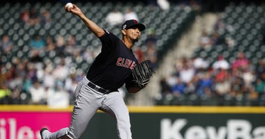 Apr 17, 2019; Seattle, WA, USA; Cleveland Indians starting pitcher Carlos Carrasco (59) throws against the Seattle Mariners during the fourth inning at T-Mobile Park. Mandatory Credit: Joe Nicholson-USA TODAY Sports