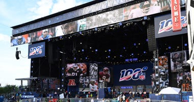 Apr 24, 2019; Nashville, TN, USA; Crews work to put the finishing touches on the main stage ahead of the NFL Draft on Broadway in downtown Nashville. Mandatory Credit: Christopher Hanewinckel-USA TODAY Sports