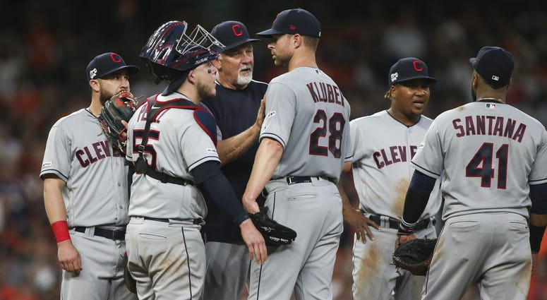 Apr 26, 2019; Houston, TX, USA; Cleveland Indians starting pitcher Corey Kluber (28) gets a mound visit from pitching coach Carl Willis (51) during the second inning against the Houston Astros at Minute Maid Park. Mandatory Credit: Troy Taormina-USA TODAY