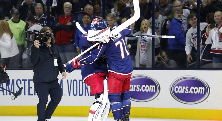 Apr 30, 2019; Columbus, OH, USA; Columbus Blue Jackets goaltender Sergei Bobrovsky (left) and left wing Nick Foligno (right) hug to celebrate, after defeating the Boston Bruins in game three of the second round of the 2019 Stanley Cup Playoffs at Nationwi