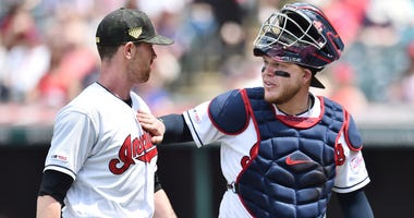 May 19, 2019; Cleveland, OH, USA; Cleveland Indians catcher Roberto Perez (55) and starting pitcher Shane Bieber (57) walk off the field during the fifth inning against the Baltimore Orioles at Progressive Field. Mandatory Credit: Ken Blaze-USA TODAY Spor