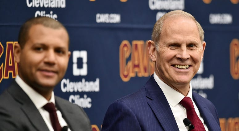 May 21, 2019; Cleveland, OH, USA; Cleveland Cavaliers head coach John Beilein (right) listens as he introduced by owner Dan Gilbert during a press conference at Cleveland Clinic Courts. At left is general manager Koby Altman. Mandatory Credit: Ken Blaze-U