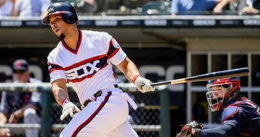 Jun 2, 2019; Chicago, IL, USA; Chicago White Sox designated hitter Jose Abreu (79) hits a double during the first inning against the Cleveland Indians at Guaranteed Rate Field. Mandatory Credit: Patrick Gorski-USA TODAY Sports