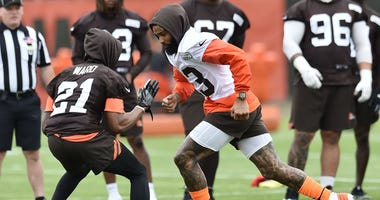 Cleveland Browns wide receiver Odell Beckham (13) runs a route against cornerback Denzel Ward (21) during minicamp at the Cleveland Browns training facility.