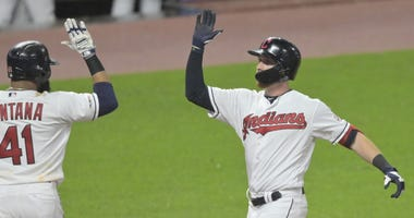 Jun 5, 2019; Cleveland, OH, USA; Cleveland Indians right fielder Jordan Luplow (8) celebrates his two-run home run with first baseman Carlos Santana (41) in the seventh inning against the Minnesota Twins at Progressive Field. Mandatory Credit: David Richa