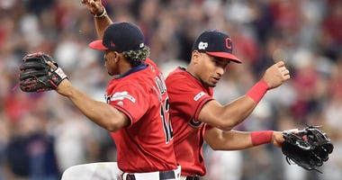 Cleveland Indians shortstop Francisco Lindor (12) and left fielder Oscar Mercado (35) celebrates after the Indians beat the New York Yankees at Progressive Field.