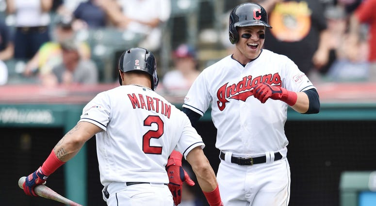 Cleveland Indians first baseman Jake Bauers, right, celebrates with Cleveland Indians center fielder Leonys Martin (2) after hitting a home run during the seventh inning against the New York Yankees at Progressive Field.