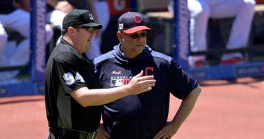 Jun 12, 2019; Cleveland, OH, USA; Home plate umpire Lance Barrett (94) talks with Cleveland Indians manager Terry Francona (77) in the fourth inning against the Cincinnati Reds at Progressive Field. Mandatory Credit: David Richard-USA TODAY Sports