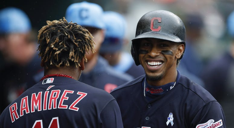 Jun 16, 2019; Detroit, MI, USA; Cleveland Indians shortstop Francisco Lindor (12) shares a laugh with second baseman Jose Ramirez (11) in the dugout during the third inning against the Detroit Tigers at Comerica Park. Mandatory Credit: Raj Mehta-USA TODAY