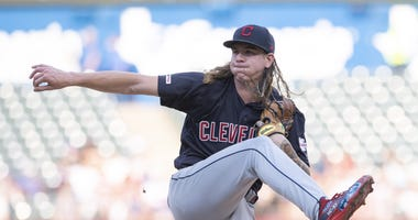 Jun 17, 2019; Arlington, TX, USA; Cleveland Indians starting pitcher Mike Clevinger (52) pitches against the Texas Rangers during the first inning at Globe Life Park in Arlington. Mandatory Credit: Jerome Miron-USA TODAY Sports