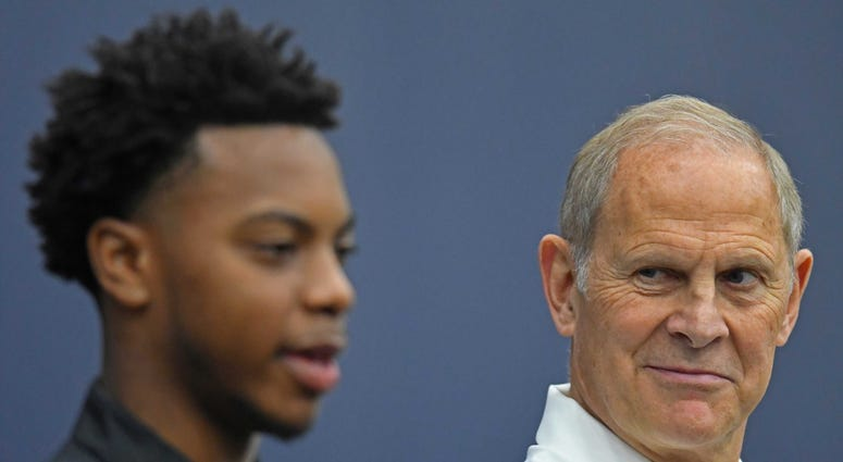 Jun 21, 2019; Independence, OH, USA; Head coach John Beilein listens as Cleveland Cavaliers first round pick Darius Garland answers questions during a press conference at Cleveland Clinic Courts. Mandatory Credit: David Dermer-USA TODAY Sports