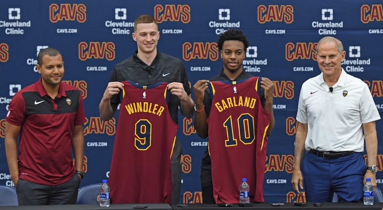 Jun 21, 2019; Independence, OH, USA; Cleveland Cavaliers first round draft picks Dylan Windler and Darius Garland show off their jerseys with General Manager Koby Altman and head coach John Beilein during a press conference at Cleveland Clinic Courts. Man
