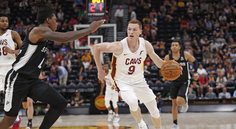 Jul 1, 2019; Salt Lake City, UT, USA; Cleveland Cavaliers Dylan Windler (9) drives against San Antonio Spurs Lonnie Walker IV (1) in the third quarter at Vivint Smart Home Arena. Mandatory Credit: Jeff Swinger-USA TODAY Sports