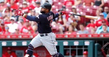 Jul 7, 2019; Cincinnati, OH, USA; Cleveland Indians first baseman Carlos Santana (41) hits a double against the Cincinnati Reds during the first inning at Great American Ball Park. Mandatory Credit: David Kohl-USA TODAY Sports