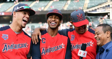Jul 8, 2019; Cleveland, OH, USA; American League pitcher Jose Berrios of the Minnesota Twins (left), infielder Francisco Lindor of the Cleveland Indians (center), and manager Alex Cora of the Boston Red Sox talk to the media during workouts before the 201