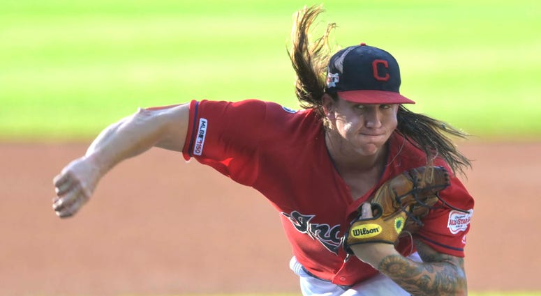 Jul 17, 2019; Cleveland, OH, USA; Cleveland Indians starting pitcher Mike Clevinger (52) delivers in the first inning against the Detroit Tigers at Progressive Field. Mandatory Credit: David Richard-USA TODAY Sports