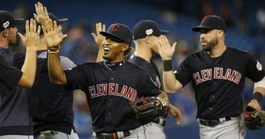 Cleveland Indians shortstop Francisco Lindor (12) and second baseman Jason Kipnis (22) celebrate a win over the Toronto Blue Jays at Rogers Centre.