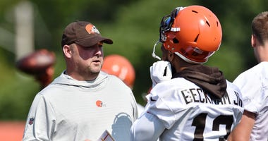 Cleveland Browns head coach Freddie Kitchens talks with wide receiver Odell Beckham (13) during training camp at the Cleveland Browns Training Complex.