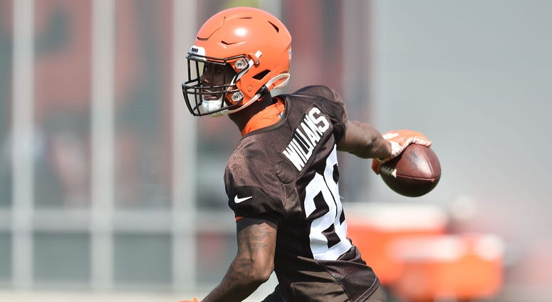 Cleveland Browns cornerback Greedy Williams (26) celebrates an interception during training camp at the Cleveland Browns Training Complex.