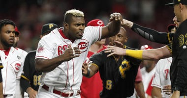 Jul 30, 2019; Cincinnati, OH, USA; Cincinnati Reds right fielder Yasiel Puig (66) charges past Pittsburgh Pirates center fielder Starling Marte (6) during a brawl in the ninth inning at Great American Ball Park. Mandatory Credit: David Kohl-USA TODAY Spor