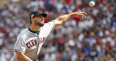 Cleveland Indians relief pitcher Brad Hand (33) throws to the Minnesota Twins in the ninth inning at Target Field.