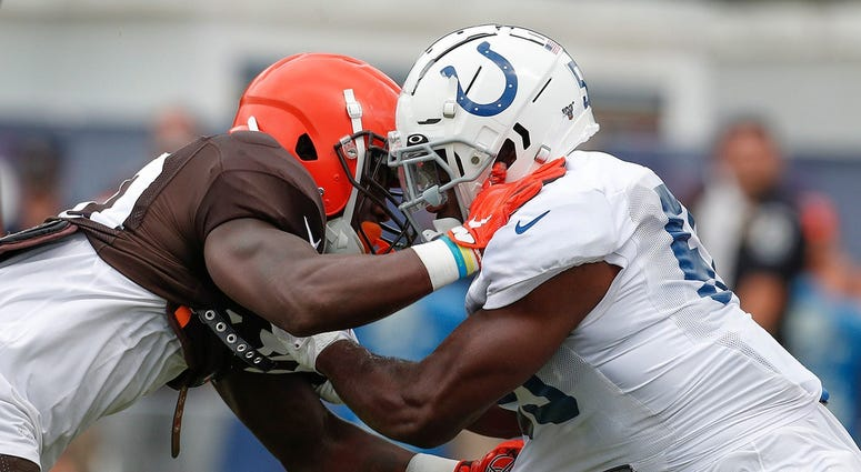 Indianapolis Colts linebacker Skai Moore (55) battles Cleveland Browns running back D'Ernest Johnson (30) during their preseason training camp practice at Grand Park in Westfield on Wednesday, August 14, 2019. Colts Preseason Training Camp