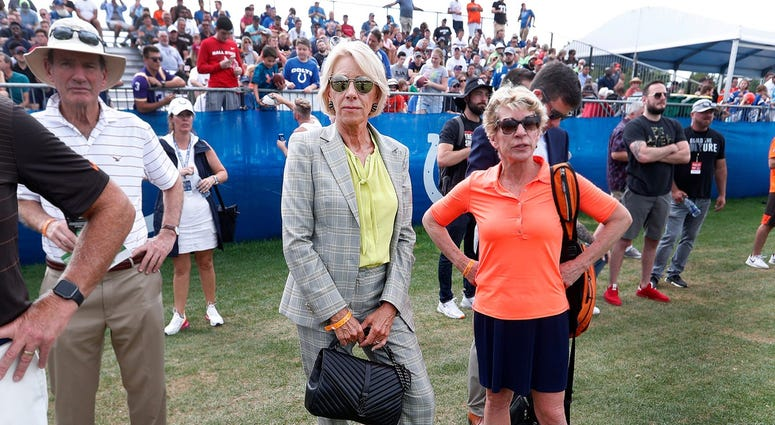 U.S. Secretary of Education Betsy DeVos, middle, watches the Indianapolis Colts and Cleveland Browns preseason training camp practice at Grand Park in Westfield on Wednesday, August 14, 2019. Colts Preseason Training Camp