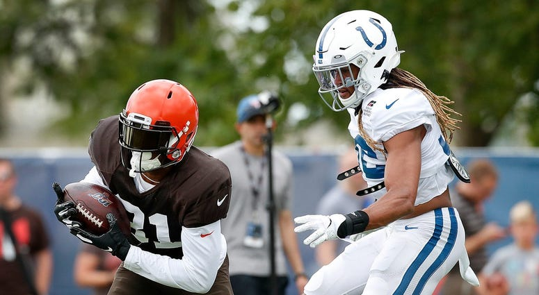 Cleveland Browns wide receiver Rashard Higgins (81) runs by Indianapolis Colts cornerback Jalen Collins (32) during their preseason training camp practice at Grand Park in Westfield on Wednesday, August 14, 2019. Colts Preseason Training CampCleveland Bro