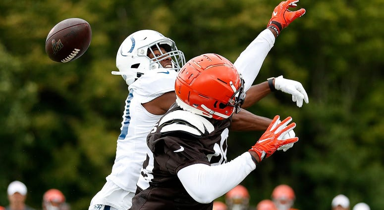 Indianapolis Colts defensive back George Odum (30) knocks the ball away from Cleveland Browns tight end Demetrius Harris (88) during their preseason training camp practice at Grand Park in Westfield on Wednesday, August 14, 2019. Colts Preseason Training