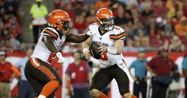 Cleveland Browns quarterback Baker Mayfield (6) fakes a handoff to running back Kareem Hunt (27) during the game against the Tampa Bay Buccaneers at Raymond James Stadium.