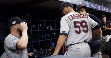 Sep 1, 2019; St. Petersburg, FL, USA; Cleveland Indians manager Terry Francona (77) hugs pitcher Carlos Carrasco (59) after he pitched the seventh inning for the first time since he was diagnosed with leukemia against the Tampa Bay Rays at Tropicana Field