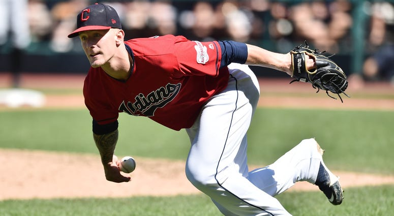 Sep 5, 2019; Cleveland, OH, USA; Cleveland Indians starting pitcher Zach Plesac (65) loses the ball as he tries to field a bunt hit by Chicago White Sox third baseman Danny Mendick (not pictured) during the sixth inning at Progressive Field. Mandatory Cre