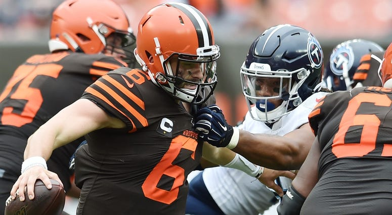 Sep 8, 2019; Cleveland, OH, USA; Tennessee Titans linebacker Sharif Finch (56) gets a hand on the shirt of Cleveland Browns quarterback Baker Mayfield (6) during the second half at FirstEnergy Stadium. Mandatory Credit: Ken Blaze-USA TODAY Sports