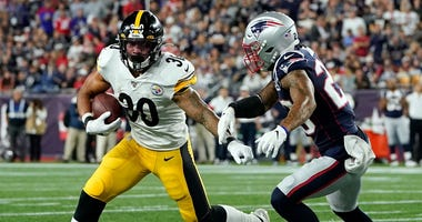 Sep 8, 2019; Foxborough, MA, USA; Pittsburgh Steelers running back James Conner (30) runs with the ball in front of New England Patriots strong safety Patrick Chung (23) during the second half at Gillette Stadium. Mandatory Credit: David Butler II-USA TOD