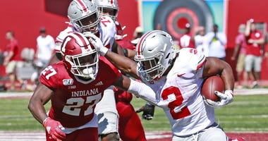 Ohio State Buckeyes running back J.K. Dobbins (2) breaks away to score a touchdown against Indiana Hoosiers defensive back Devon Matthews (27) during the second quarter at Memorial Stadium.