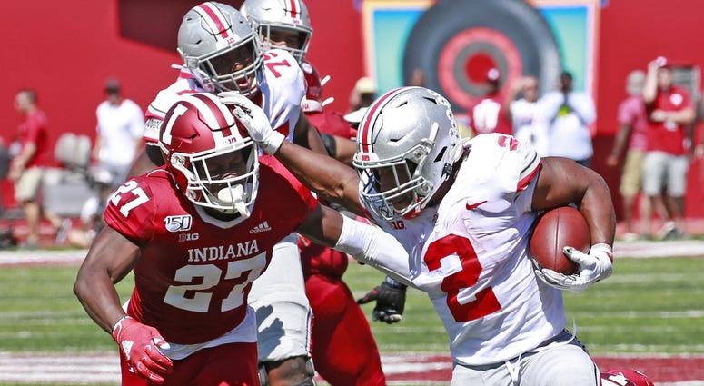 Ohio State Buckeyes running back J.K. Dobbins (2) breaks away to score a touchdown against Indiana Hoosiers defensive back Devon Matthews (27) during the second quarter at Memorial Stadium.