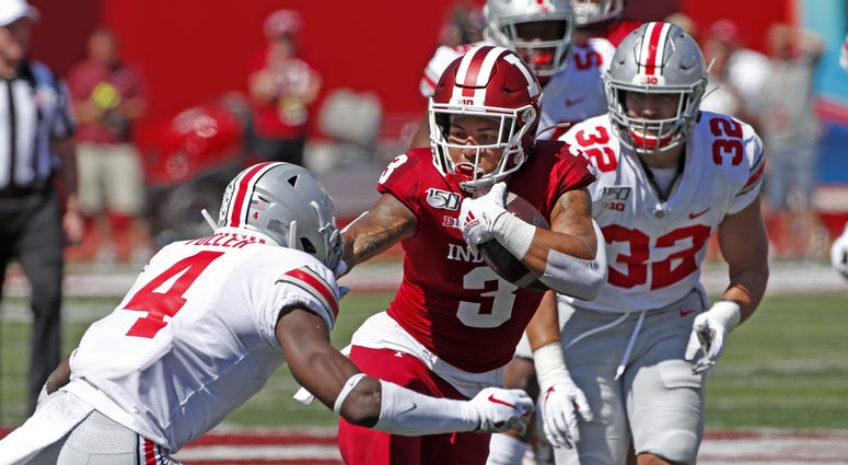 Indiana Hoosiers wide receiver Ty Fryfogle (3) runs with the ball against Ohio State Buckeyes safety Jordan Fuller (4) during the third quarter at Memorial Stadium