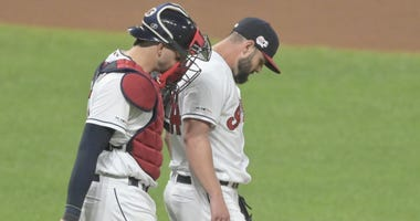 Sep 14, 2019; Cleveland, OH, USA; Cleveland Indians catcher Kevin Plawecki (27) talks with relief pitcher Nick Goody (44) in the eighth inning against the Minnesota Twins at Progressive Field. Mandatory Credit: David Richard-USA TODAY Sports